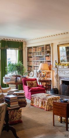 Colorful sitting room chock-full of books. Love the crown molding and decorative mantel.