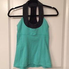 Lululemon Scoop Neck Tank Teal Lululemon Scoop Neck Tank with charcoal neckline. Built in bra top. Two small bleach spots in the front. Otherwise still in good condition lululemon athletica Tops Tank Tops