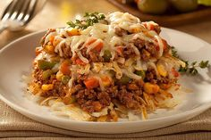 Lasagna casserole is a great weeknight dish. Made with hash browns, ground beef, and mixed veggies this Lasagna Fry is sure to please!
