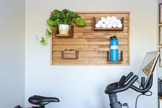 Spin bike shelf spin bike shoe holder home gym wall shelf | Etsy | gym towel diy # Outdoor Console Table, Wine Storage Cabinets, Clean Patio, Towel Storage, Towel Shelf, Craft Storage, Storage Ideas, Bike Shelf, Shoe Holders