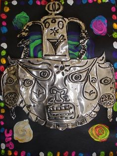 Aztec tin mask- good for 3rd grade- connects to their social studies...
