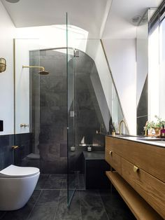 #bathroom | The master ensuite provides a brass shower under the stars and a toilet with a view of the clouds. The slate tiles can be used as blackboards. © Justin Alexander