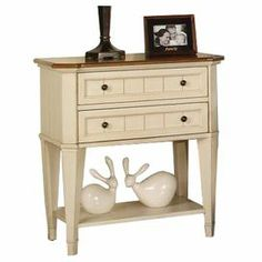 """Featuring an antique ivory and caramel finish and spacious lower storage opening, this classic nightstand makes a charming addition to your master suite.     Product: Nightstand    Construction Material: Pine solids and okume veneers     Finish: Antique ivory and caramel    Features:  Geometric design    Two drawers    Ball bearing drawer guides   Dimensions: 30"""" H x 28"""" W x 19"""" D"""