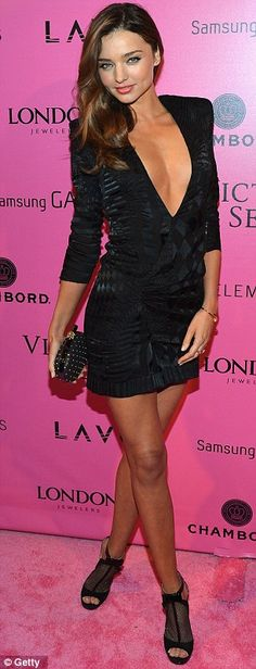 Battle of the LBDs: Model Shanina Shaik tried to outdo her more famous rival Miranda Kerr but failed