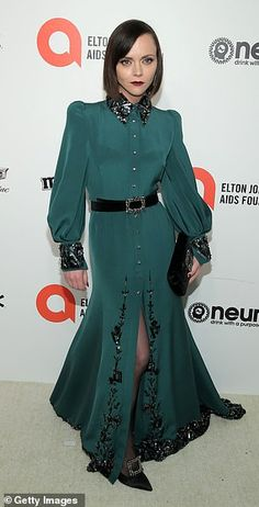 Elegant arrivals: Christina Ricci looked chic in a forest green gown with an embellished c...