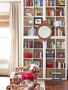 This storage-packed bookcase is actually made up of four inexpensive shelving units! Kate of Centsational Girl shares more ways to use these budget-friendly shelves