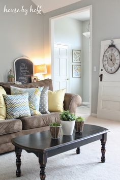 Home Tour, House by Hoff - I knew one of these days I would find it... our brown couch! Looks great with grey walls!