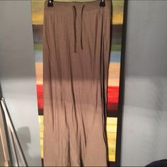 Tan Maxi Skirt Brand New Never worn; the tag was torn off but it still has that plastic thing. Old Navy Skirts Maxi