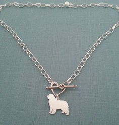 Newfoundland Dog Thick Sterling Silver Chain Necklace, Personalize Pendant, Breed Silhouette Charm, Rescue Shelter, Dog Memorial jewelry The Newfoundland dog is loved by so many. This Newfie charm chain necklace is hand made with love from solid sterling silver. The large thick chain is accented with a heart toggle closure that the pendant hangs from. Personalize with an intial or name on pendant Pendant Size approx. ~ 5/8 (15mm) x 15/16 (23mm) Necklace Length ~ various lengths available…