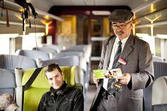Train staff checking a traveler's pass