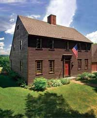 The saltbox originated in New England, & is an example of American colonial architecture. One theory holds that the saltbox form was popularized by Queen Anne's taxation of houses greater than one story. Since the rear of the roof descended to the height of a single-story building, the structure was exempt from the tax.More likely, though, the saltbox shape evolved organically from the need for additional space for growing families; adding a lean-to was an economical way to enlarge the house.