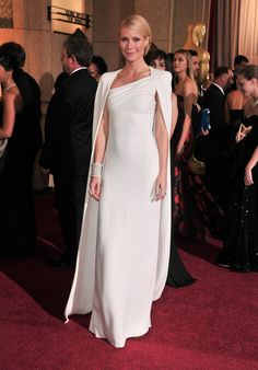 We pinpoint Tom Ford's 26 most memorable red carpet looks. Here, Gwyneth Paltrow in Tom Ford. See more on Vogue.com.