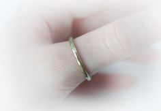 This is a unique brass ring made in my studio. This is a simple minimalist thick band ring that is hammered and textured. For him or her! 2 mm wide ringband.  Ring size: 8 2/3 US Most of my creations are made to look raw and bohemian and thus have a rough finish, freeform cut and unique apearance. I select the raw materials, cut, solder, form, chisel, patina and shine my items myself in my studio. Please check out my other items too, I hope one of them has your name on it! I do combine s...