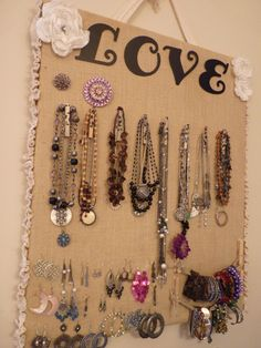 Re-purposed canvas painting with one sheet of fabric, burlap, and a few decorations to make a jewelry board. Love it!