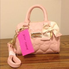 """FLASH SALE!! NWT Betsey Johnson baby pink bag!! FLASH SALE!!!! NWT Betsey Johnson baby pink bag with a cute bow!! Super adorable !!!  Measures approx 7.5"""" in length & 6"""" in height Betsey Johnson Bags"""