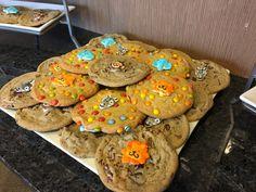 Safari Theme Baby Shower   Safari animal cake decorations added to chocolate chip cookies are a fun dessert option!