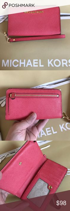 mk phone/wristlet Cards holder, bills can be in pockets, fit iPhone 6 & 7. No plus! Coral pink. Like new condition never use no tag. Michael Kors Bags Clutches & Wristlets