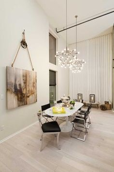 Venice Loft contemporary dining room. I really like the drama of this painting the way it's hung and on a wall with high ceilings.