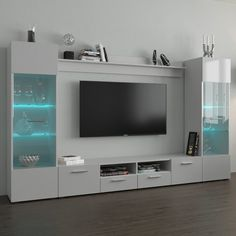 Modica Modern Wall Unit Entertainment Center - Modern Wall Unit / Entertainment Console / Entertainment CenterHigh gloss fronts with matte color LED light system included with color control and on/off remoteManufactured in and imported . Modern Tv Room, Modern Tv Wall Units, Modern Wall, Tv Unit Decor, Tv Wall Decor, Tv Cabinet Design, Tv Wall Design, Tv Wanddekor, Tv Unit Interior Design