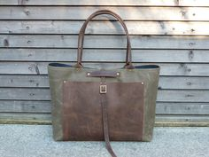 Waxed canvas tote bag/ carry all with waxed leather handles and waxed leather outside pocket COLLECTION UNISEX. $179.00, via Etsy.
