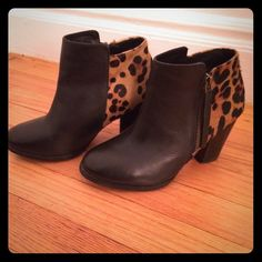 Black and leopard ankle booties Black and leopard ankle booties. incredibly comfortable. Zip up on the side. About a 3 inch heel. Rubber grip on the bottom of the boot. ALDO Shoes