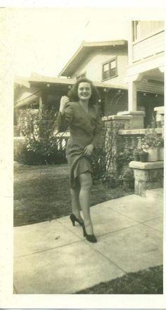 6be1155157 1940s Pin Up Girl Lifting Skirt Showing Thigh 40s Vintage Photograph Black  White Photo