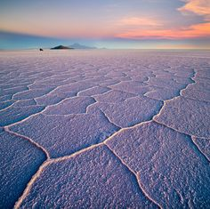 Salar de Uyuni hexagons at sunset, Bolivia, March 2014  Salar de Uyuni is part of the Altiplano of Bolivia in South America. The Altiplano is a high plateau, which was formed during uplift of the Andes mountains. The plateau includes fresh and saltwater lakes as well as salt flats and is surrounded by mountains with no drainage outlets. Salar de Uyuni (or Salar de Tunupa) is the world's largest salt flat at 12,106 square kilometers.