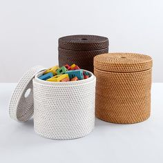 The Land of Nod | Rattan I Am Storage Collection Round Floor Basket in Floor Storage - for Legos and trains in sunroom