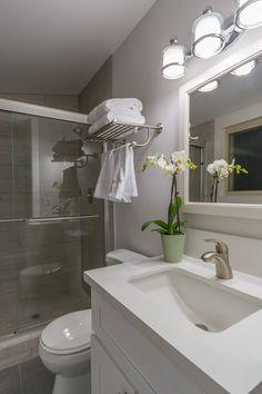 Contemporary 3/4 Bathroom with High ceiling, Limestone, Kichler lacey 3 light bath vanity light, frameless showerdoor, Flush