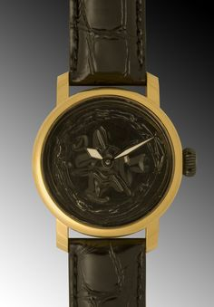 Handmade Mechanical Watch with a 3D aluminium dial from the Grand Cru series. Dial made of a used coffee capsule available end of nov 2012
