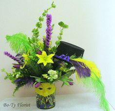 Flower Arrangement with a Mardi Gras theme.