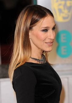 A centre parting and poker-straight hair makes SJP's locks the star of the show...