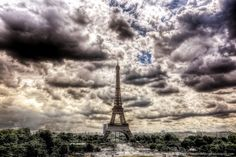 The Eiffel Tower touches the skies above Paris.