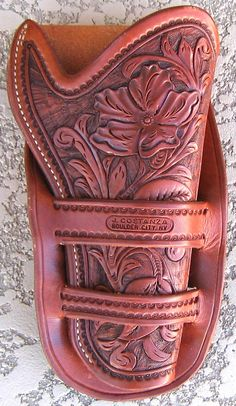 western leather holster, single action holster, cowboy holster, traditional old west holster Cowboy Holsters, Western Holsters, Leather Tooling, Tooled Leather, Colt Single Action Army, Custom Leather Holsters, Pink Guns, Cowboy Action Shooting, Pistol Holster