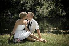 bride & groom sitting by the pond-Marlette, Michigan