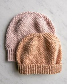 f94a66a1cf49 A hat that feels as good as it looks, the Fluffy Brioche Hat is an free  knit hat pattern that reminds us of a toasted pastry.