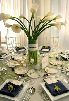 Navy,white, and bright green accents. Cylinder vases filled with South American calla lilies,banded in white grosgrain ribbon. Clean,modern centerpieces **** Saved this as Callalillies are my absolute favorite and I will have them at my wedding Calla Lily Centerpieces, Modern Centerpieces, Simple Wedding Decorations, Simple Weddings, Table Centerpieces, Wedding Centerpieces, Wedding Table, Table Decorations, Church Decorations