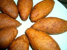 Kibbeh (Fried Beef Croquettes) - Brazilian culture contains its own unique mixture and combination of many different influences from all over the world.   These small deep fried beef treats have become one of the most popular snacks to eat in Brazil. The combination in seasonings of garlic, mint, cinnamon, and nutmeg along with the deep fried beef and onions makesan unbelievable savory snack. This is a simple and easy way to make this super popular and delicious eat without all the fuss!