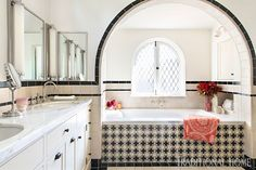 Mix and Chic: Inside a beautifully layered and charming Spanish Colonial Revival in Los Angeles! Spanish Colonial, Spanish Style, Spanish Revival, Spanish House, White Medicine Cabinet, Medicine Cabinets, Leaded Glass Windows, Front Courtyard, Black And White Tiles