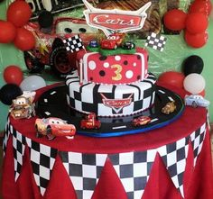 Red tablecloth under checkered tablecloth; red and black balloons in tires