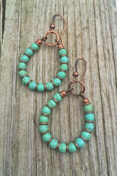 "Handmade turquoise and copper hoop earrings that are small and very light weight. Approx 1.5"" in length."