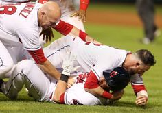 11th wonder:     Cleveland Indians' Yan Gomes, bottom, is tackled by Jason Kipnis and Chris Gimenez, left, after hitting a single to score the winning run against the Texas Rangers during the 11th inning on June 1 in Cleveland. The Indians won 5-4.