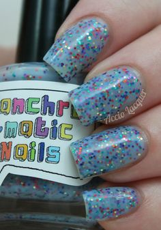 She Is Confused Nail Polish - bright blue jelly with rainbow glitter