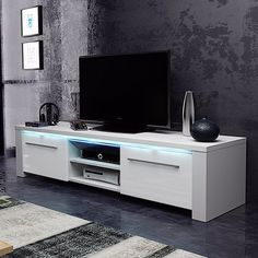This chic TV stand is the ideal solution for storing your TV and HiFi devices. The high-gloss lacquered stand features an interesting design and offers plenty of space with its classic shelf and three drawers with push-open function. Tv Cabinets, Tv Stand With Bracket, Armoire Tv, Buy Tv Stand, Swivel Tv Stand, Tv Unit Furniture, Tv Bench, Home Furniture