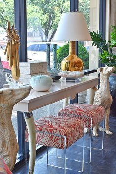 Could those upholstered lucite benches be any more fabulous?