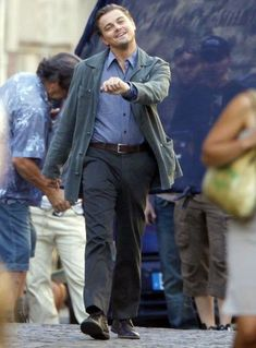 "Leo Strut | Know Your Meme:  The original image is of DiCaprio doing a jolly strut down a street during the filming of Christopher Nolan's ""Inception""."
