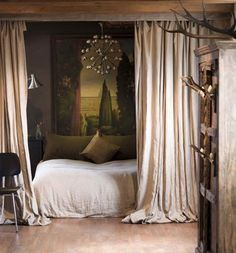 I love this idea to create privacy in a studio apartment. It gives a sultry feel without closing off a space and making it too dark.
