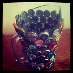 beer pitcher with beer bottle caps hot glued on.  perfect craft for all those ones saved up!