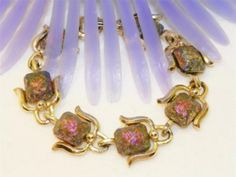 Vintage Carnival glass bracelet. True vintage costume jewelry from the 1950's era. Beautiful carnival aurora borealis molded glass stones. Very unique.
