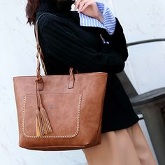 78b35fe295 Description   Detail Tote leather shoulder bag with four interior pockets  which of two have a